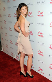 Bridget Moynahan struck a pose in classic black leather peep-toe pumps.