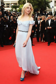 Clemence Poesy updated her romantic pale blue gown with knockout turquoise suede peep-toes.