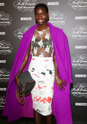 Jeneil Williams accessorized with a chic chain-strap bag by Stella McCartney when she attended the Pirelli Calendar 50th anniversary press conference.