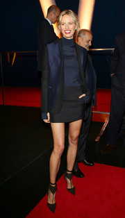 Karolina Kurkova completed her modern ensemble with black T-strap Ferragamo pumps featuring double ankle straps.