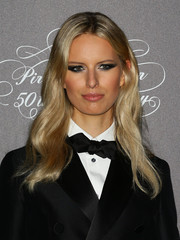 Karolina Kurkova looked like a doll with her super-shiny blond wavy 'do at the Pirelli Calendar 50th anniversary event.