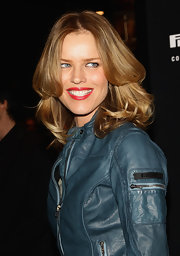 Eva Herzigova's smile was a roaring red at the Pirelli Corse Venezia flagship store opening. To try her look, we recommend a product like Covergirl LipPerfection Lipcolor in Hot.