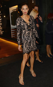 Ines looked lovely in a patterned dress with lace up detail at the opening of the Pirelli flagship store.