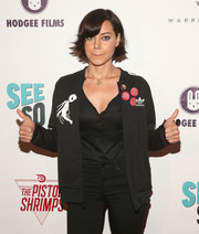 Aubrey Plaza arrived for the premiere of 'The Pistol Shrimps' looking athletic in an Adidas track jacket.