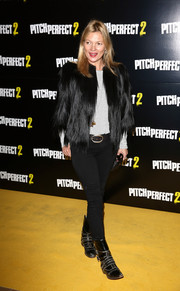 Kate Moss was edgy-glam in distressed moto boots, skinny jeans, and a fur jacket at the 'Pitch Perfect 2' VIP screening.