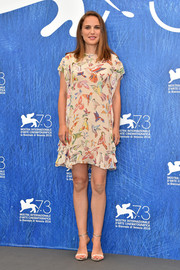 Natalie Portman styled her dress with gold and white ankle-strap sandals by Christian Dior.