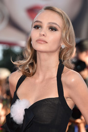 Lily-Rose Depp pulled her look together with a pair of elegant diamond studs.