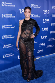 Halsey attended the Planned Parenthood 100th anniversary gala looking racy in a sheer, one-sleeve black gown by Jonathan Simkhai.