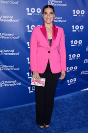 America Ferrera completed her ensemble with a custom box clutch by Edie Parker.