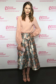 Amanda Crew opted for a demure blush top with blouson sleeves when she attended the Politics, Sex & Cocktails event.