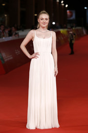 Dakota Fanning looked simply divine in a pleated ivory gown by J. Mendel at the Rome Film Fest screening of 'Please Stand By.'