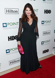 Lisa Vanderpump added a bright spot with a printed fuchsia clutch.