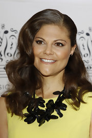 Princess Victoria looked classic with these deep-side parted waves.
