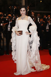 Fan Bingbing added shine to her glamorous white gown with a pewter hard case clutch.