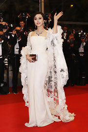 Fan Bing Bing looked ethereal in a white evening gown with an extravagant feathered shawl for the Cannes Film Festival.