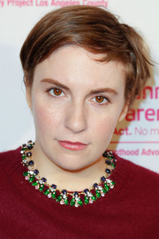 Lena Dunham looked breezy wearing this short side-parted 'do at the Politics, Sex and Cocktails event.
