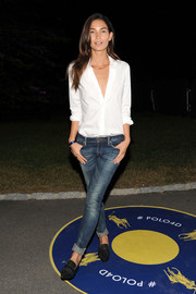 Lily Aldridge sealed off her look with a pair of black pointy flats.