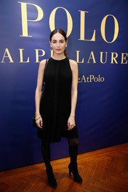Camilla Belle completed her ensemble with black tights and ankle boots.