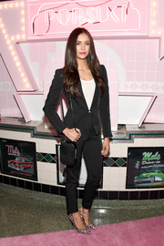 Nina Dobrev attended the launch of Pop & Suki suited up in black Armani.