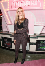 Georgia May Jagger went old-school in a checkered pantsuit at the launch of Pop & Suki.
