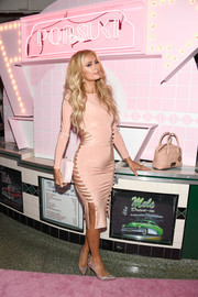 Paris Hilton went for a dazzling finish with a pair of iridescent pumps.