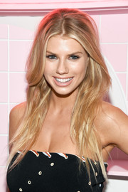 Charlotte McKinney wore her hair down in a sexy tousled style during the Pop & Suki launch.
