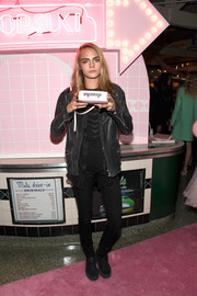 Cara Delevingne topped off her tough-chic outfit with a black leather jacket.