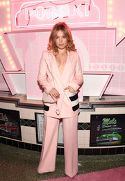 Poppy Elizabeth Jamie matched her suit with a personalized pink camera bag by Pop & Suki.