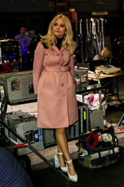 Pixie Lott showed off her cute winter style with this belted pink wool coat during the Post Office Christmas campaign shoot.