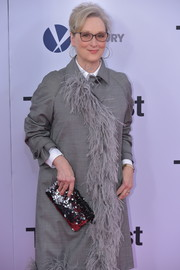 Meryl Streep got fancy with this paillette clutch and feathered coat combo by Prada at the Washington, DC premiere of 'The Post.'