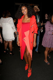 Solange Knowles layered an oversized red leather jacket over an asymmetrical color-block dress for the Lexus Design Disrupted event.