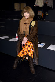 Anna Wintour was luxuriously bundled up in a brown fur coat as she sat front row at the Prabal Gurung fashion show.