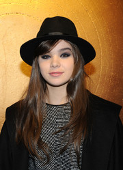 Hailee Steinfeld topped off her outfit with a classic black fedora.