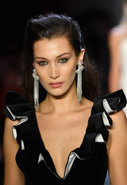 Bella Hadid showed off a stunning pair of diamond and pearl chandelier earrings by TASAKI Atelier.