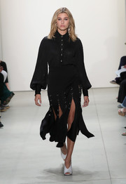 Hailey Baldwin was conservative up top in a long-sleeve black button-down while walking the Prabal Gurung runway.