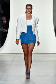 Taylor Hill channeled the '80s with this strong-shouldered cropped jacket at the Prabal Gurung runway show.