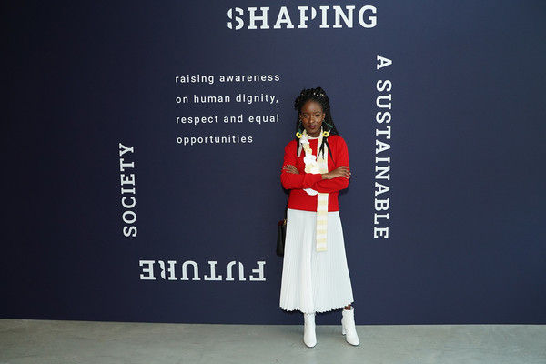 Amanda Gorman paired a red crewneck sweater with a cute knit scarf for the 'Shaping a Sustainable Future Society' conference.