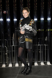 Helena Bordon looked like a rock star in this embellished leather coat by Prada during the brand's Fall 2018 show.