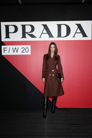 Emily Ratajkowski bundled up in style with a brown trenchcoat by Prada for the brand's Fall 2020 show.