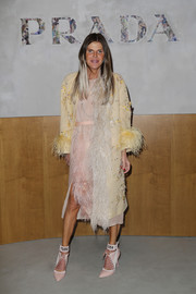 Anna dello Russo looked fancy in a beaded and feathered coat by Prada while attending the label's Fall 2017 show.