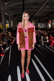 Chiara Ferragni teamed a fringed leather and suede jacket with a crop-top and a mini skirt for the Prada fashion show.