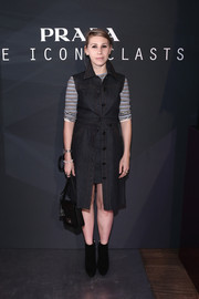 Zosia Mamet kept it relaxed in a black Prada button-up denim dress layered over a striped shirt during the label's Iconoclasts event.