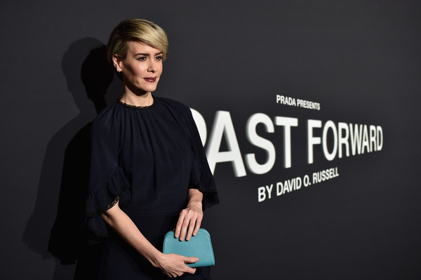 Sarah Paulson brightened up her black dress with a turquoise leather clutch by Prada when she attended the LA premiere of 'Past Forward.'