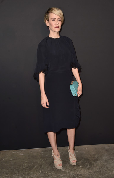 Sarah Paulson styled her dress with strappy nude platform sandals.