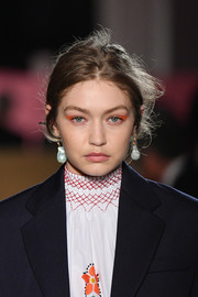 Gigi Hadid's eyes couldn't be missed thanks to her neon-orange shadow.