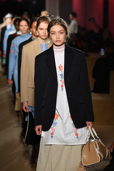 Gigi Hadid toted a beige leather bowler bag while walking the Prada Resort 2020 runway.