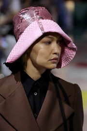 Gigi Hadid rocked a pink snakeskin bucket hat at the Prada Spring 2020 show.
