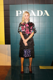Chiara Ferragni sported a rose-print blouse at the Prada Spring 2020 show.