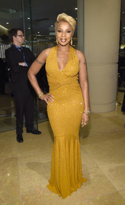 Mary J. Blige slipped into a micro-beaded mustard gown by Michael Kors, featuring a gathered waist and a fluted hem, for the pre-Grammy gala.