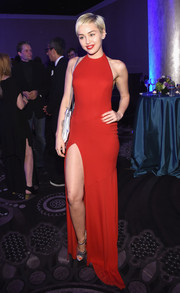Miley Cyrus donned a red Alexandre Vauthier halter gown for the pre-Grammy gala. It was refreshing to see her a little more covered up than usual.
